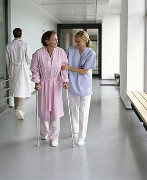 "<img src=""200252890-001.jpg"" alt=""nurse helping patient walk in a long term care facility"">"