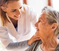 a nurse walking with a patient in a skilled nursing facility