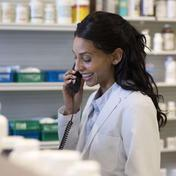 A registered pharmacist counsels a patient
